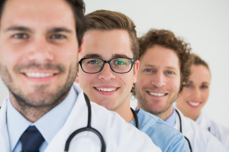 Portrait of confident medical team in a row at hospital photo