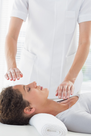 Young woman receiving alternative therapy at health spa photo