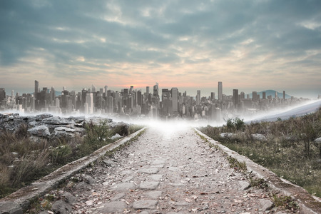 Stony path leading to large city on the horizon
