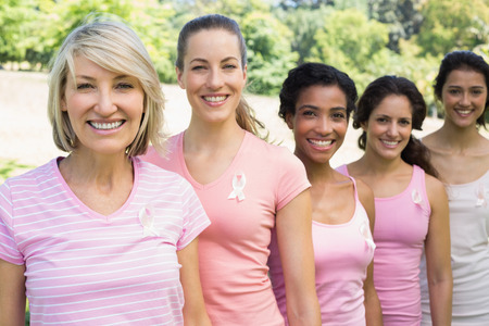 Group of female volunteers participating in breast cancer awareness  photo