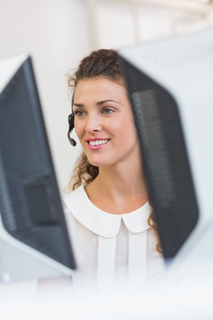 customer service representative: Happy female customer service representative working in call center Stock Photo