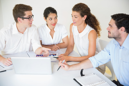 young adult man: Business people discussing in office meeting Stock Photo