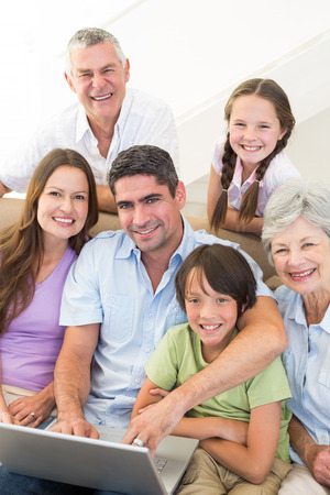 Portrait of loving multigeneration family spending leisure time at home photo