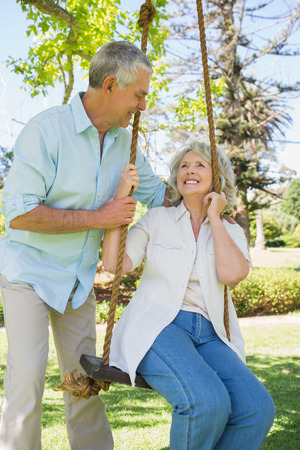 adult couple: Portrait of a happy and loving mature couple at the park Stock Photo