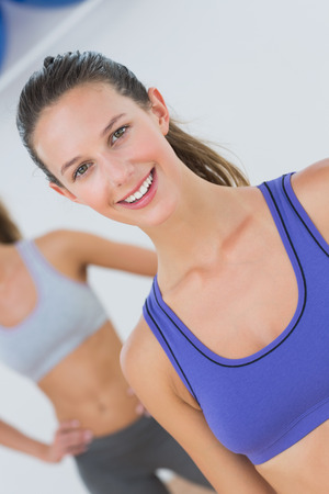 sports bra: Portrait of fit young women in sports bra at fitness studio