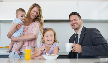 Portrait of happy family at table in house photo