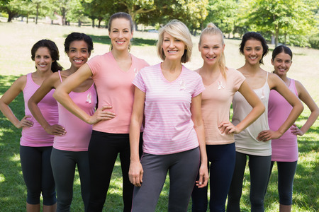 Portrait of happy women participating in breast cancer awareness at park photo