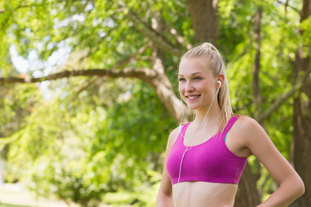 pink bra: Healthy and beautiful young woman in sports bra jogging in the park