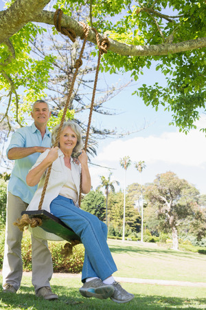 Low angle portrait of a happy mature couple at the park photo