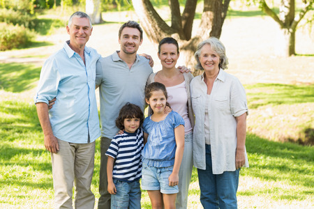 extended: Portrait of a happy extended family standing in the park Stock Photo