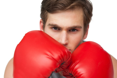 body concern: Fit man wearing red boxing gloves on white background