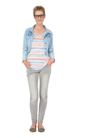 casually: Full length of a casually dressed young woman over white background