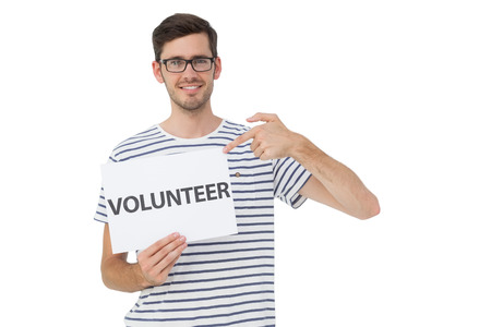 Portrait of a happy young man pointing at donation welcome note over white background photo
