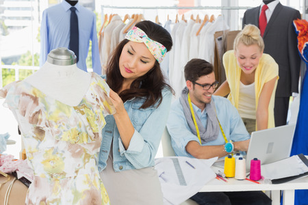 Group of fashion designers at work in a studio photo