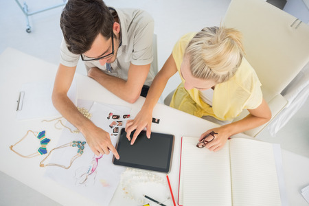 Overhead view of two fashion designers using digital laptop in a studio Stock Photo - 27142975
