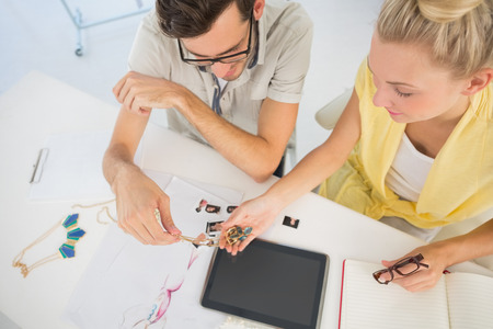 Overhead view of two fashion designers using digital laptop in a studio Stock Photo - 27142976