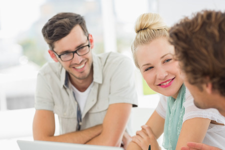 working together: Closeup of a group of casual people working in a bright office