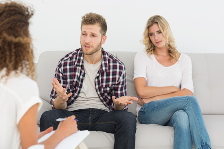couples therapy: Man speaking to therapist at couples therapy at therapy session