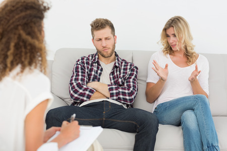 couples therapy: Woman speaking to therapist at couples therapy at therapy session