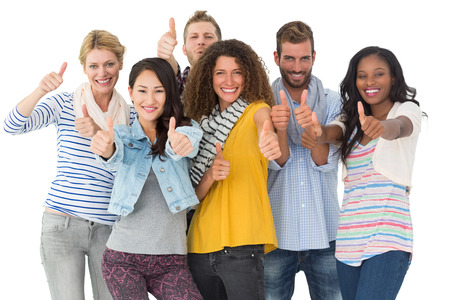 Happy group of young friends giving thumbs up to camera on white background photo