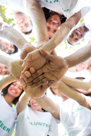environmentalists: Low angle view of multiethnic environmentalists stacking hands