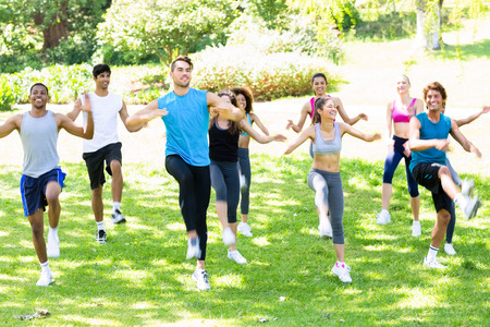 Group of multiethnic people exercising in the park photo