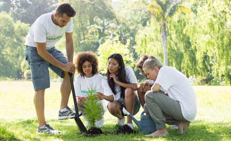 environmentalists: Group of multiethnic environmentalists planting in park