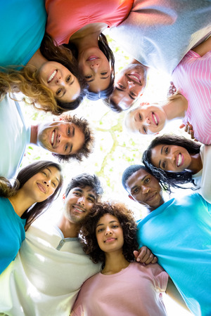huddle: Low angle portrait of confident friends forming huddle Stock Photo