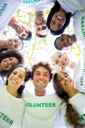 environmentalists: Low angle portrait of multiethnic environmentalists forming huddle