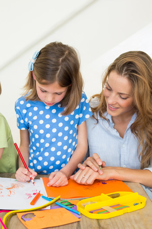 Mother and daughter coloring at home photo