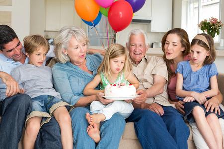 house party: Multigeneration family celebrating girls birthday at home