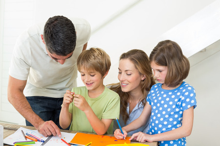 Happy family of four coloring at home photo
