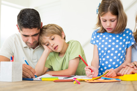 Father and children coloring at home photo
