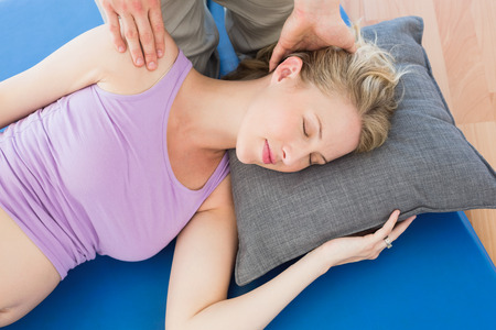 Pregnant woman having a relaxing massage in a studio photo