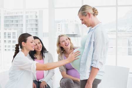 Smiling pregnant women at antenatal class at the hospital photo