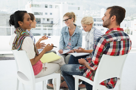 casual business: Group of casual young people in meeting at office