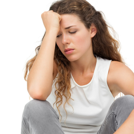 Close-up of a sad young woman over white background Stock Photo