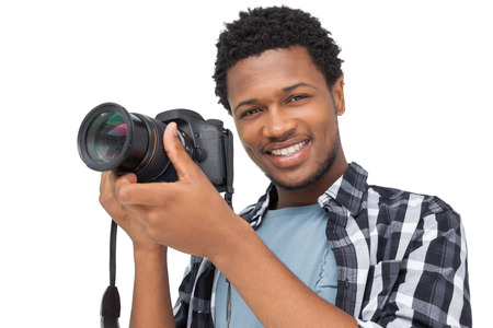 Portrait of a happy male photographer over white background photo