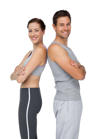 mains crois�es: Portrait of a happy fit young couple with hands crossed over white background