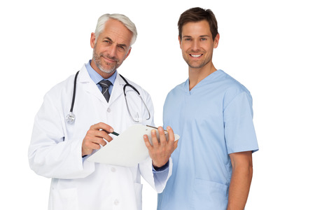 Portrait of male doctor and surgeon with reports over white background photo