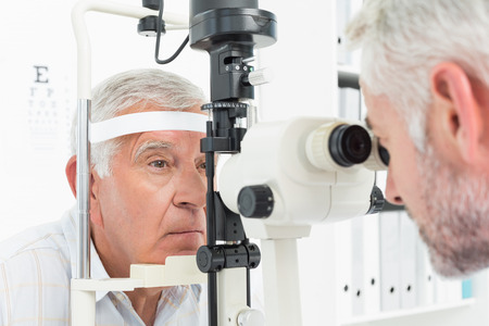 ophthalmic: Close-up of an optometrist doing sight testing for senior patient Stock Photo