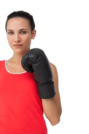 Portrait of a determined female boxer focused on her training over white background photo