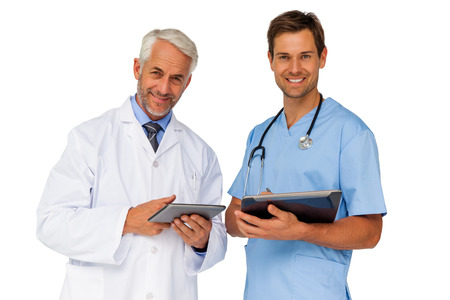 Portrait of male doctor and surgeon with digital tablets over white background photo