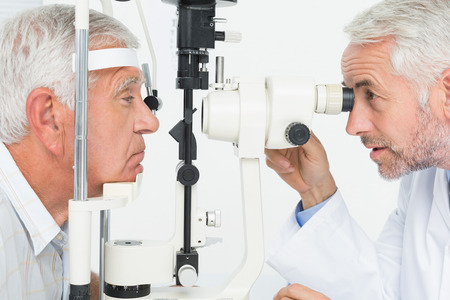Close-up of an optometrist doing sight testing for senior patient photo
