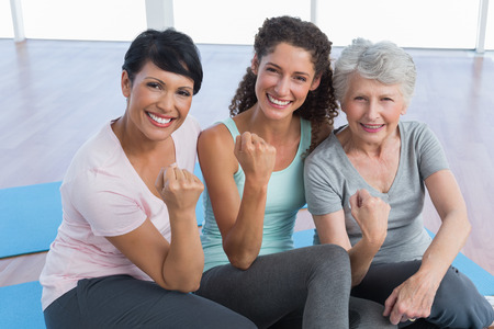 Portrait of happy women sitting in the yoga class