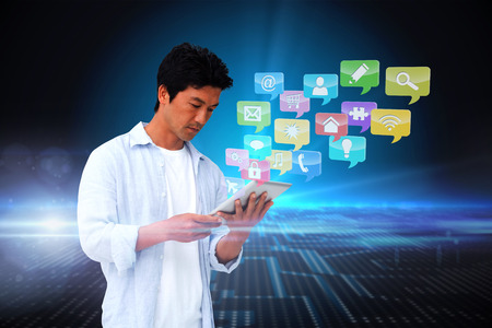 using tablet: Digital composite of casual man using tablet with app icons Stock Photo
