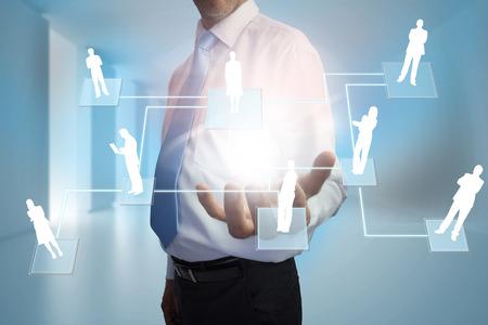 representations: Digital composite of businessman presenting links between human representations