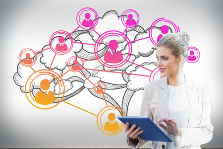 Digital composite of blonde businesswoman using tablet pc with cloud computing graphic photo