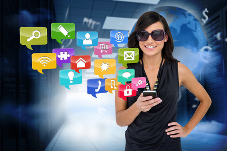 glamorous: Digital composite of glamorous brunette using smartphone with app icons