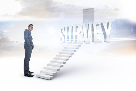 The word survey and smiling businessman standing against white steps leading to closed door photo